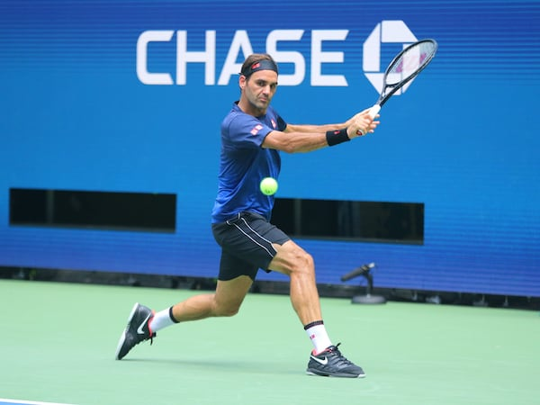 Roger Federer US Open 2019 Wearing Light and Dark Blue Uniqlo wear and Nike Shoes.