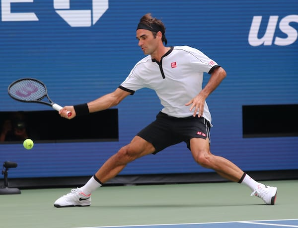 Roger Federer - Full Body Shot - US Open 2019 - Wearing white and black Uniqlo set - And white Nike Shoes.