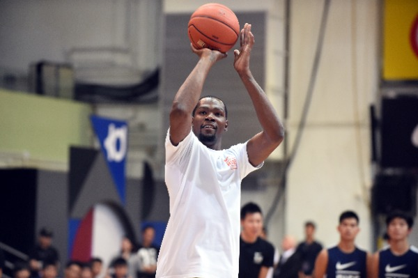 NBA star Kevin Durant shows his basketball skills at a promotional event for Nike Rise Academy during his Asia tour in Hong Kong, China, 12 July 2016.