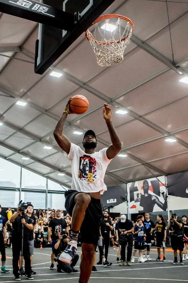 NBA star LeBron James of Los Angeles Lakers shows his basketball skills during his China tour in Shanghai, China, 25 August 2018.
