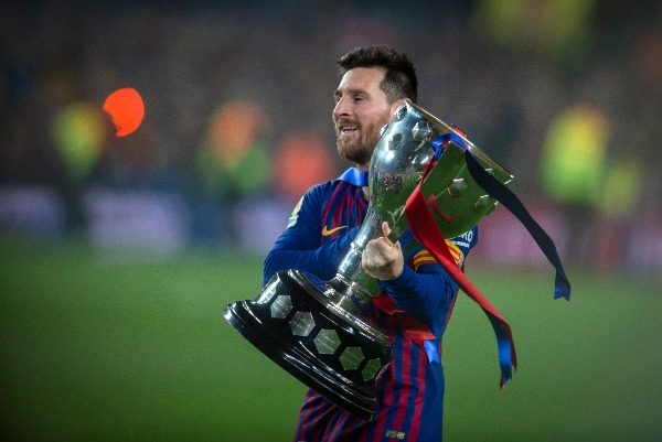 Lionel Messi of FC Barcelona holds the champion trophy after his team defeated Levante UD during their 35th round match of the La Liga 2018-2019 season at Camp Nou Stadium in Barcelona, Spain, 27 April 2019.