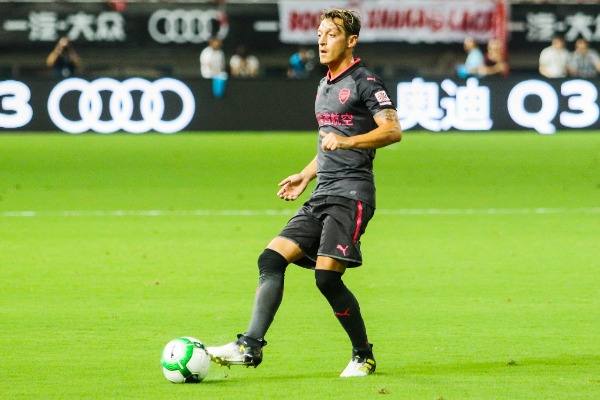 Mesut Ozil of Arsenal kicks the ball to make a pass against Bayern Munich during the Shanghai match of the 2017 International Champions Cup China in Shanghai, China, 19 July 2017.