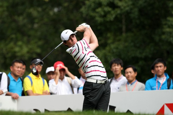 Golfer Rory McIlroy of Northern Ireland plays a shot in the first round match of the HSBC Champions golf tournament in Shanghai, China, 31 October 2013.