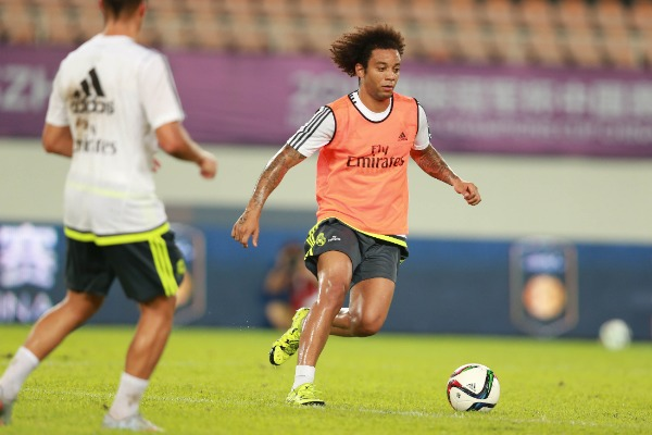 Marcelo Vieira, right, and teammates of Real Madrid take part in a training session in Guangzhou city, south China's Guangdong province, 26 July 2015