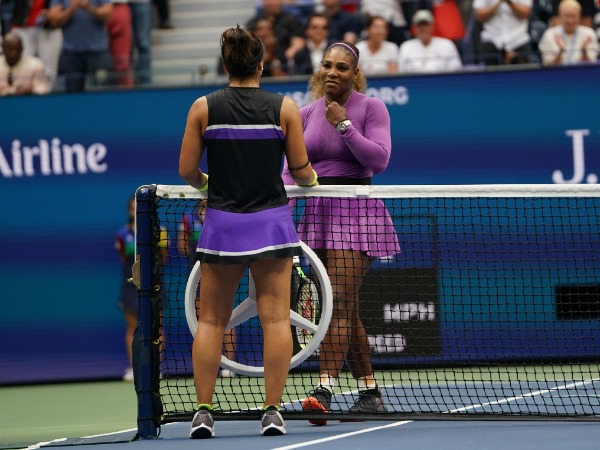 NEW YORK - SEPTEMBER 7, 2019: 2019 US Open champion Bianca Andreescu of Canada embraces Serena Williams at the net following her win in the final match at Billie Jean King National Tennis Center in New York