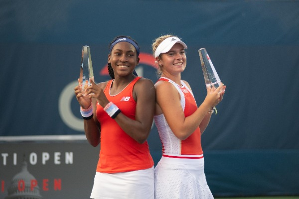 Coco Gauff (USA) and Caty McNally (USA) celebrate their doubles championship at the Citi Open tennis tournament on August 3, 2019 in Washington DC
