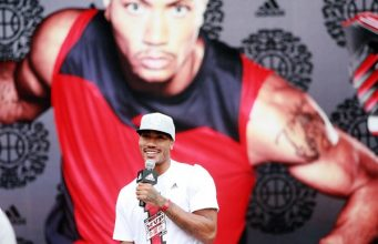 NBA star Derrick Rose of the Chicago Bulls speaks at a meeting with fans during his China tour in Shanghai, China, 23 August 2011
